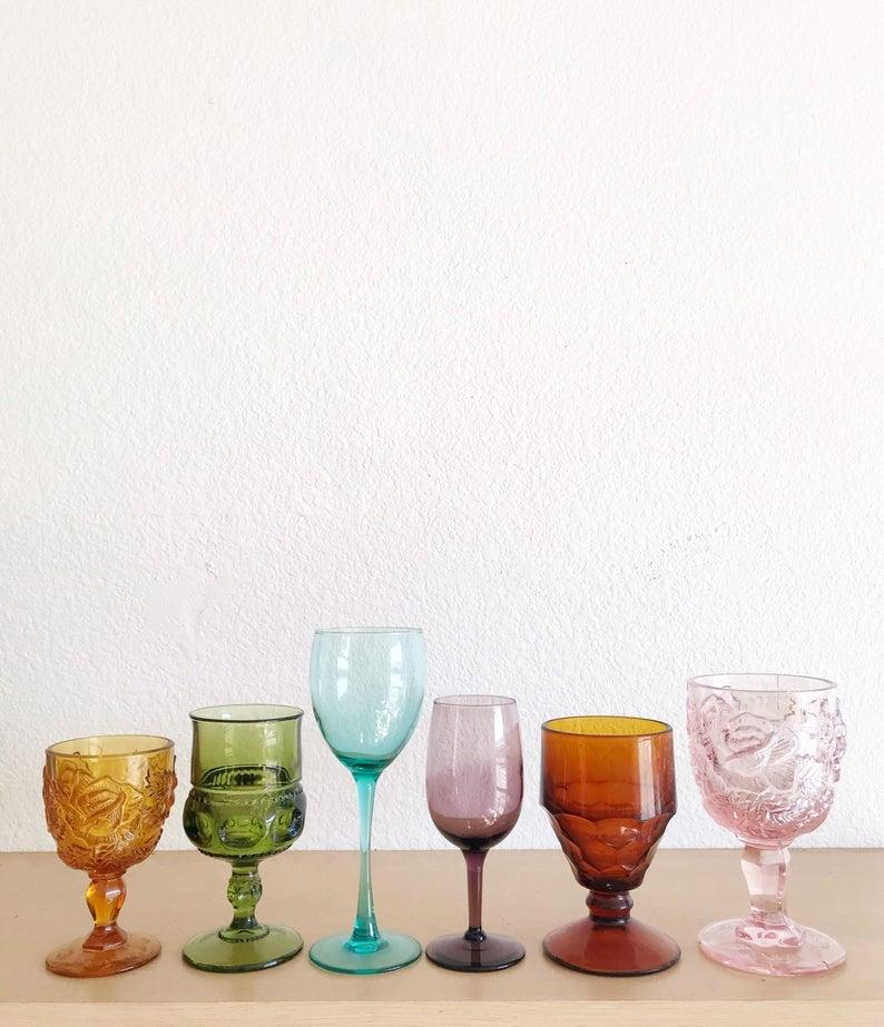 """<h3><a href=""""http://ww.etsy.com/listing/768327266/mismatched-collection-of-6-ornate-amber"""" rel=""""nofollow noopener"""" target=""""_blank"""" data-ylk=""""slk:Etsy Mismatched Vintage Glassware Set"""" class=""""link rapid-noclick-resp"""">Etsy Mismatched Vintage Glassware Set</a></h3><br><a href=""""https://refinery29.com/en-us/what-to-buy-with-100-dollars"""" rel=""""nofollow noopener"""" target=""""_blank"""" data-ylk=""""slk:What would we (and our readers) buy with $100"""" class=""""link rapid-noclick-resp"""">What would we (and our readers) buy with $100</a>? Apparently a luminous set of mismatched glassware from <a href=""""https://www.etsy.com/shop/simplychi"""" rel=""""nofollow noopener"""" target=""""_blank"""" data-ylk=""""slk:Simplychi Vintage's"""" class=""""link rapid-noclick-resp"""">Simplychi Vintage's</a> treasure shop on Etsy. <br><br><strong>simplychi</strong> Mismatched Vintage Glass Set (6), $, available at <a href=""""https://www.etsy.com/listing/768327266/mismatched-collection-of-6-ornate-amber"""" rel=""""nofollow noopener"""" target=""""_blank"""" data-ylk=""""slk:Etsy"""" class=""""link rapid-noclick-resp"""">Etsy</a>"""