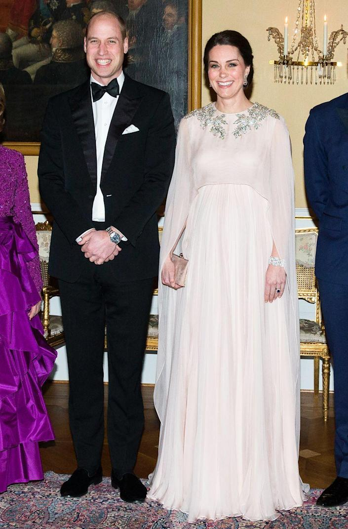 """<p>Will and Kate embarked on<a href=""""https://www.townandcountrymag.com/society/tradition/g15917756/photos-kate-middleton-royal-tour-sweden-norway-2018/"""" rel=""""nofollow noopener"""" target=""""_blank"""" data-ylk=""""slk:a royal tour of Norway and Sweden"""" class=""""link rapid-noclick-resp""""> a royal tour of Norway and Sweden</a> in early 2018. The Duchess chose an ethereal blush pink gown by Alexander McQueen that featured a cape and stunning crystal detailing for a formal state dinner during the royal visit. </p>"""