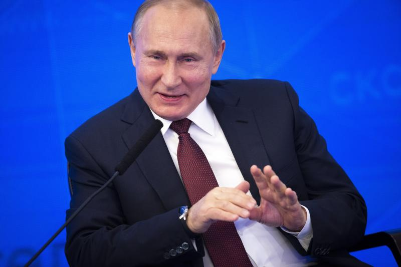 Russian President Vladimir Putin gestures while speaking at a meeting of the Russian Union of Industrialists and Entrepreneurs in Moscow, Russia, Thursday, March 14, 2019. Putin urged the business community to engage more actively in major infrastructure projects and vowed to create more incentives and help reduce investment risks. (AP Photo/Alexander Zemlianichenko)