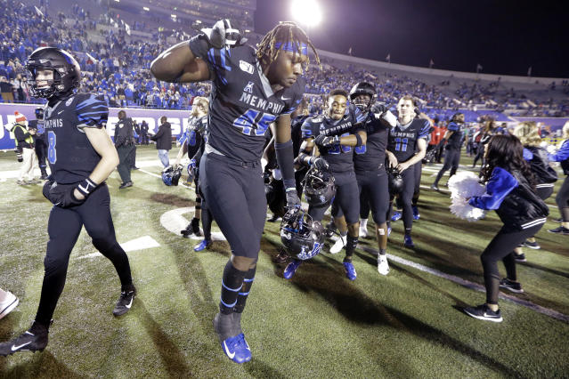 Memphis tight end Kameron Wilson (45) dances after his team defeated Cincinnati in an NCAA college football game Friday, Nov. 29, 2019, in Memphis, Tenn. (AP Photo/Mark Humphrey)