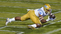 UCLA tight end Mike Martinez catches a pass for a touchdown against Colorado late in the second half of an NCAA college football game Saturday, Nov. 7, 2020, in Boulder, Colo. (AP Photo/David Zalubowski)