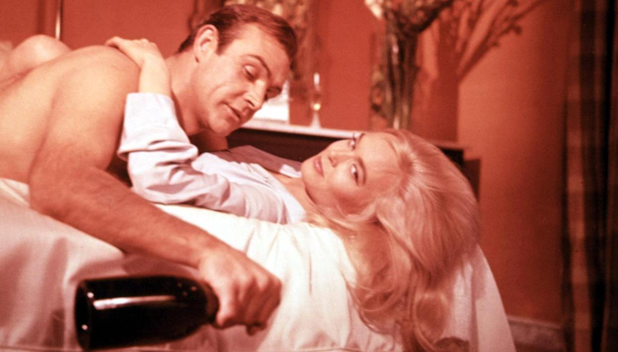 Sean Connery and Shirley Eaton in the 1964 James Bond adventure, Goldfinger (Photo: Courtesy Everett Collection)