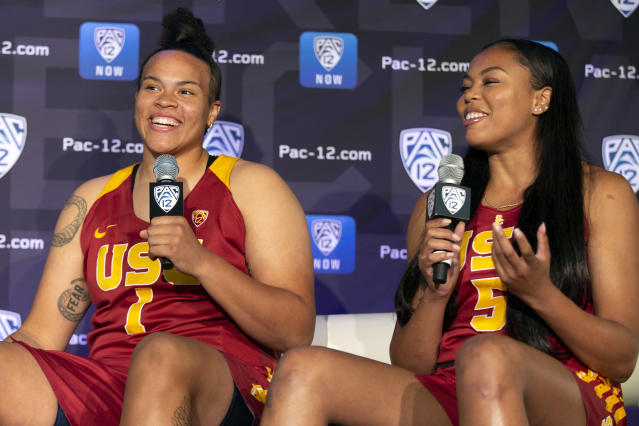 Southern California's Kayla Overbeck, left, and Stephanie Watts answer questions from reporters during the Pac-12 Conference women's NCAA college basketball media day, Monday, Oct. 7, 2019, in San Francisco. (AP Photo/D. Ross Cameron)