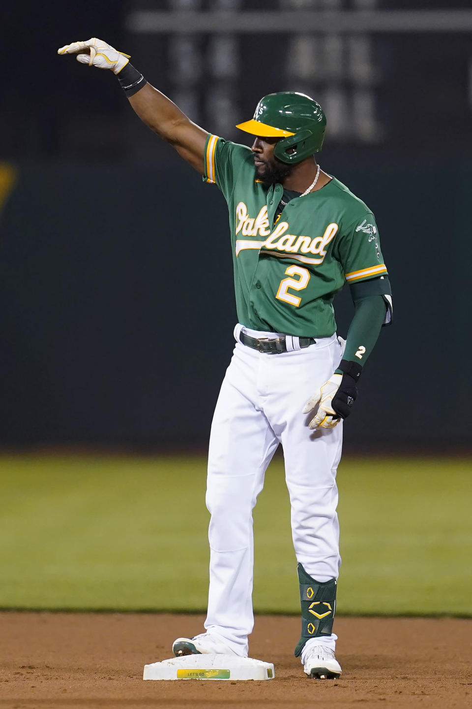 Oakland Athletics' Starling Marte gestures toward teammates after hitting an RBI double against the San Francisco Giants during the seventh inning of a baseball game in Oakland, Calif., Friday, Aug. 20, 2021. (AP Photo/Jeff Chiu)