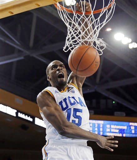 UCLA's Shabazz Muhammad dunks against Washington in the second half of an NCAA college basketball game in Los Angeles on Thursday, Feb. 7, 2013. UCLA won 59-57. Muhammad scored 22 points and had eight rebounds. (AP Photo/Reed Saxon)
