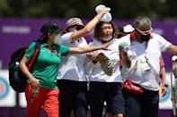 <p>People help Russian athlete Svetlena Gombaeva after she felt faint during the Archery - Ranking Round on Tokyo 2020 Summer Olympics at Yumenoshima Park in Tokyo, Japan on July 23, 2021. (Photo by Ali Atmaca/Anadolu Agency via Getty Images)</p>