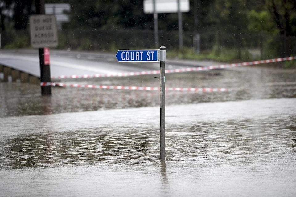 <p>A submerged street sign in New South Wales. <span>According to news reports</span>, the rain caused Warragamba Dam, which is Sydney's primary source of water, to overflow for the first time in five years. Residents in New South Wales are currently evacuating. </p>