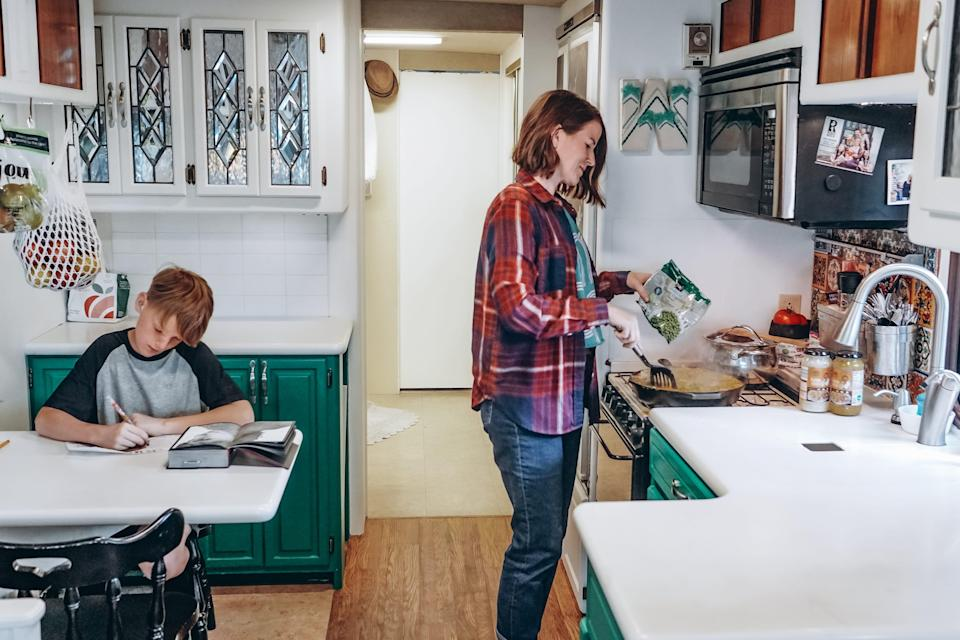 mom and son in the kitchen of walker family RV