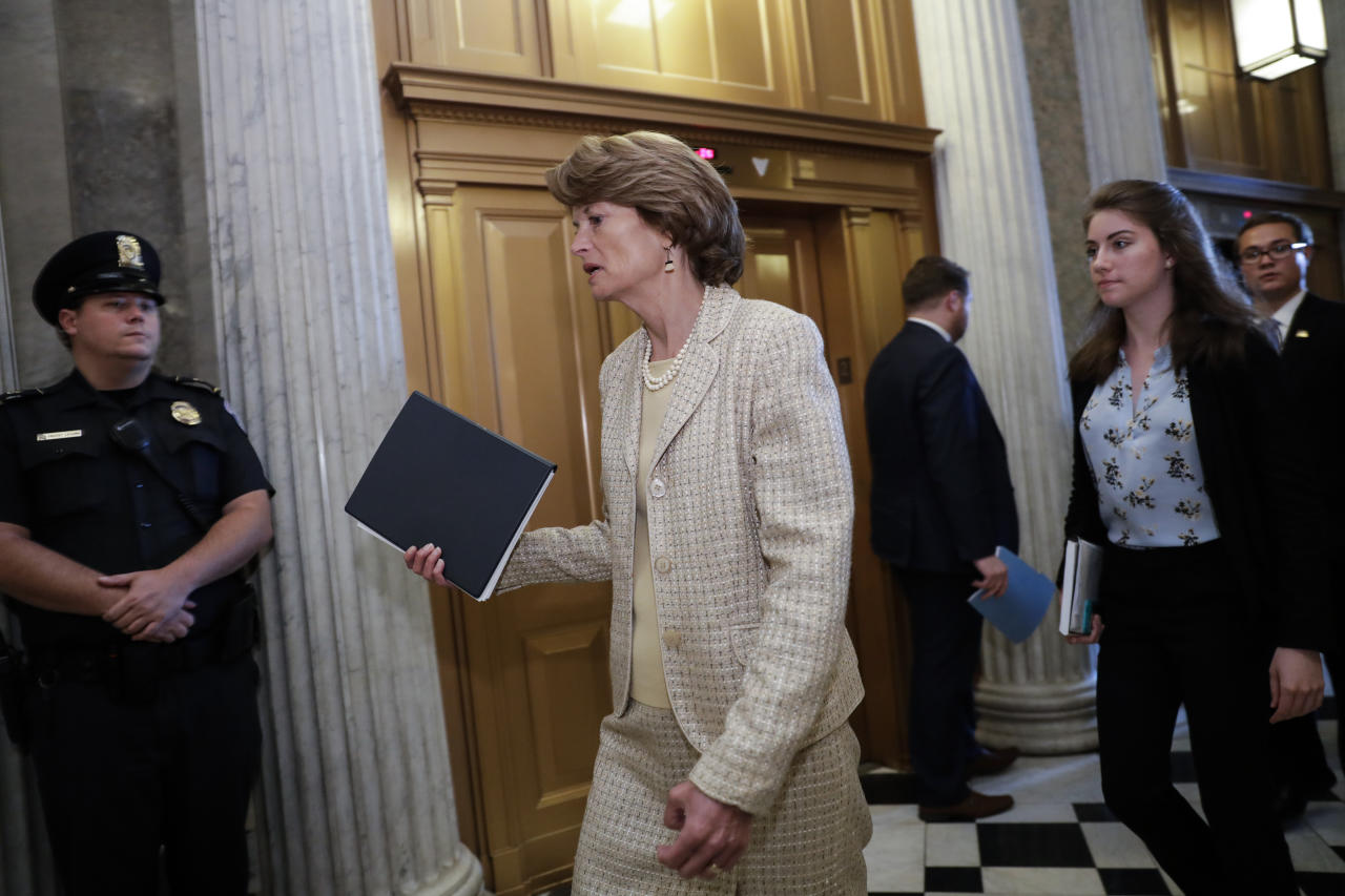 Sen. Lisa Murkowski, R-Alaska, arrives for a vote as the Republican-run Senate rejected a GOP proposal to scuttle President Barack Obama's health care law and give Congress two years to devise a replacement, Wednesday, July 26, 2017, at the Capitol in Washington. President Donald Trump and Senate Majority Leader Mitch McConnell, R-Ky., have been stymied by opposition from within the Republican ranks. (AP Photo/J. Scott Applewhite)