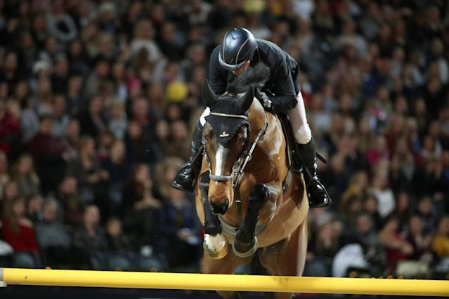 Equestrian - Sweden International Horse Show - International jumping - Qualification for Sweden Masters - Friends Arena, Stockholm, Sweden - December 1, 2017. John Whitaker of Britain on a horse Crumley jumps. TT News Agency/Soren Andersson/via REUTERS ATTENTION EDITORS - THIS IMAGE WAS PROVIDED BY A THIRD PARTY. SWEDEN OUT. NO COMMERCIAL OR EDITORIAL SALES IN SWEDEN
