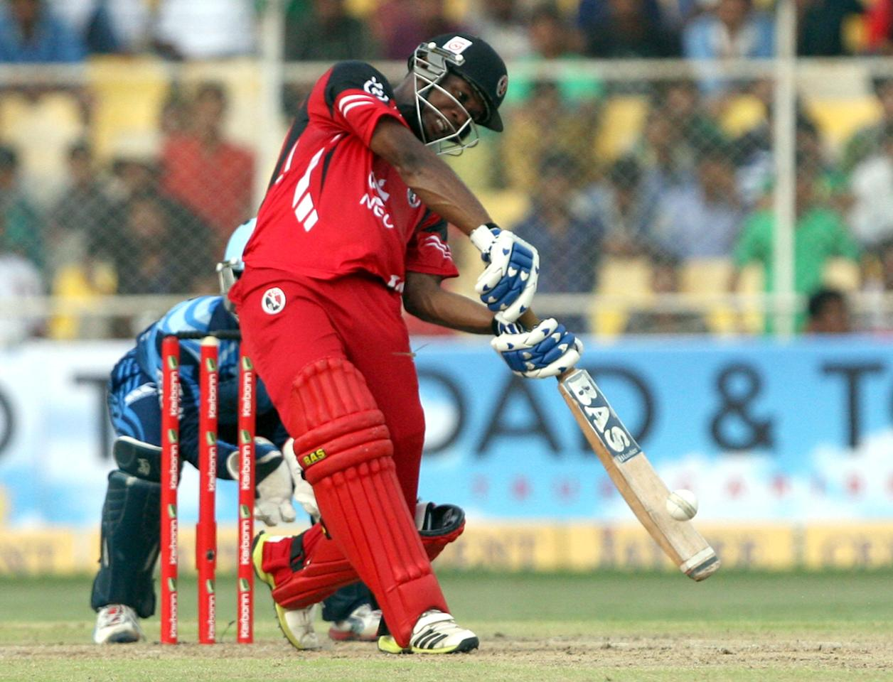 E Lewis in action during the CLT20 match between Titans and Trinidad & Tobago at Sardar Patel Stadium, Motera in Ahmedabad on Sept. 30, 2013. (Photo: IANS)