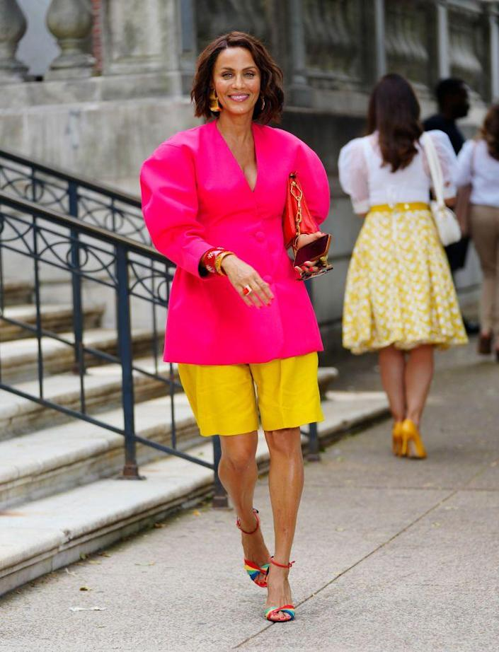 <p>Nicole Ari Parker wore a bright-pink puff-sleeved top paired with Max Mara linen gabardine shorts. She accessorized with a Louis Vuitton Coussin PM bag, Linda Farrow oversized Keaton glasses, and a pair of rainbow sandals by Yves Saint Laurent.</p>