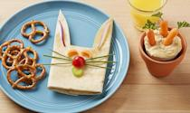 """<p>Pull this <a href=""""https://www.goodhousekeeping.com/holidays/easter-ideas/how-to/g3354/how-to-make-a-bunny-shaped-wrap/"""" rel=""""nofollow noopener"""" target=""""_blank"""" data-ylk=""""slk:rabbit wrap"""" class=""""link rapid-noclick-resp"""">rabbit wrap</a> out of your hat for a <a href=""""https://www.goodhousekeeping.com/ideas-kids-school-lunches/"""" rel=""""nofollow noopener"""" target=""""_blank"""" data-ylk=""""slk:healthy afternoon treat"""" class=""""link rapid-noclick-resp"""">healthy afternoon treat</a>. For a super cute side, fill a paper cup with hummus and make it look like baby carrots are sprouting up from it.</p>"""