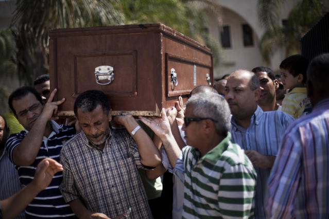 Friends and relatives of Ammar Badie, 38, killed Friday by Egyptian security forces during clashes in Ramses Square, and also son of Muslim Brotherhood's spiritual leader Mohammed Badie, carry his coffin during his funeral in al-Hamed mosque in Cairo's Katameya district, Egypt, Sunday, Aug. 18, 2013. Egypt increased security at the Supreme Constitutional Court building ahead of planned mass rallies by supporters of the country's ousted President Mohammed Morsi. (AP Photo/Manu Brabo)