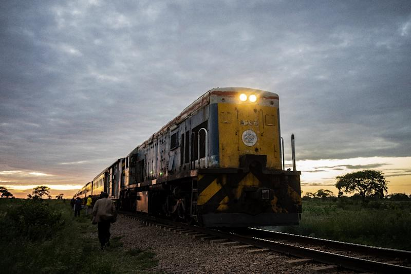 The commuter train known as the 'Freedom Train' nears a station in Cowdray Park township, Bulawayo, as dawn light rises on a late January day (AFP Photo/Zinyange Auntony)