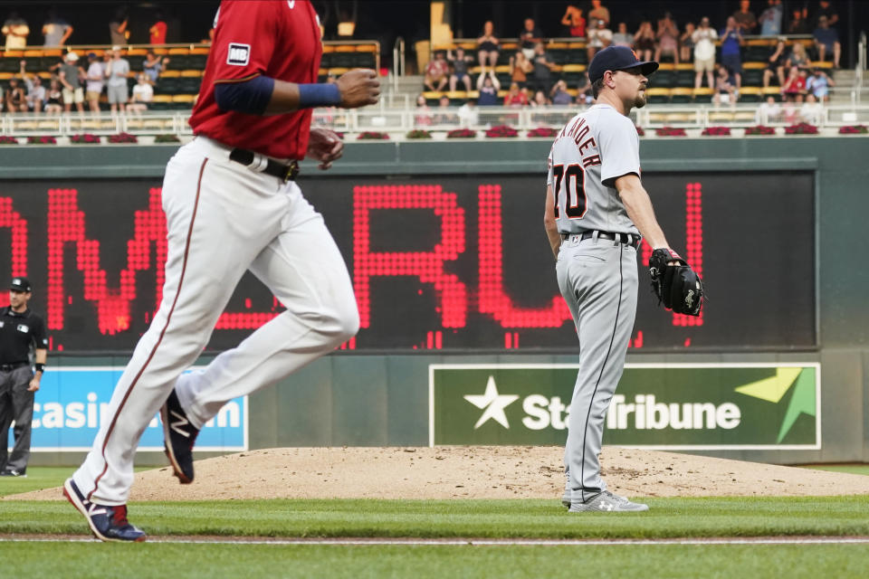Detroit Tigers pitcher Tyler Alexander, right, reacts after Minnesota Twins' Mitch Garver's grand slam off Alexander during the first inning of a baseball game Tuesday, July 27, 2021, in Minneapolis. (AP Photo/Jim Mone)