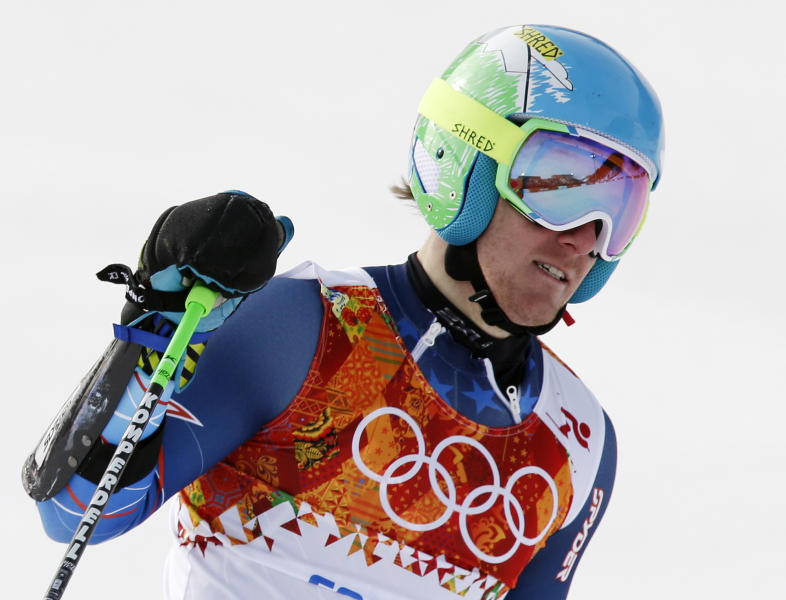 United States' Ted Ligety pauses after finishing in the first run of the men's giant slalom at the Sochi 2014 Winter Olympics, Wednesday, Feb. 19, 2014, in Krasnaya Polyana, Russia. (AP Photo/Gero Breloer)