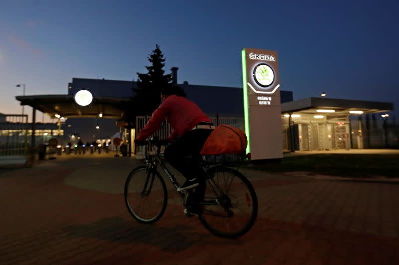 A cyclist rides past Skoda Auto's factory as the company restarts production after shutting down last month due to the coronavirus disease (COVID-19) outbreak in Mlada Boleslav