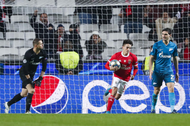 Benfica's Franco Cervi, center, celebrates after scoring past Zenit goalkeeper Mikhail Kerzhakov, left, the opening goal during the Champions League group G soccer match between Benfica and Zenit St. Petersburg at the Luz stadium in Lisbon, Tuesday, Dec. 10, 2019. (AP Photo/Armando Franca)