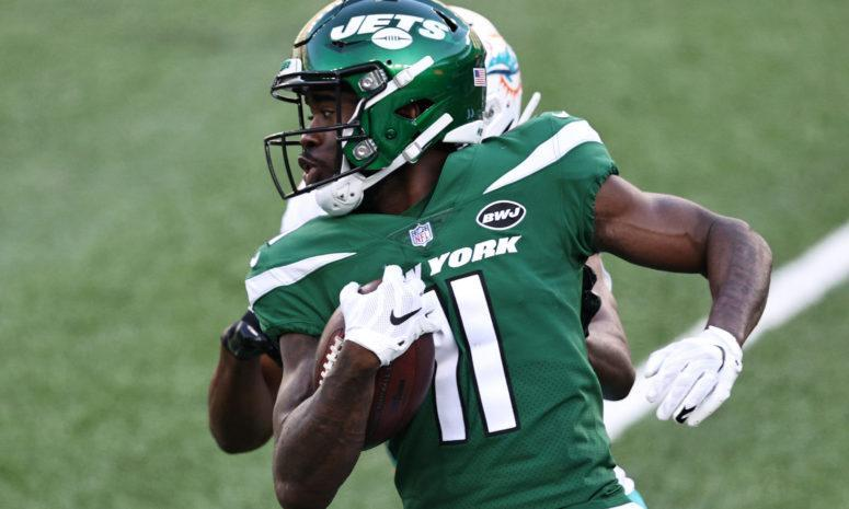 Denzel Mims runs with the ball for the New York Jets against the Miami Dolphins.