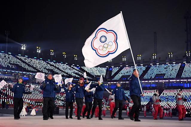 <p>Flag bearer Te-An Lien of Chinese Taipei and teammates enter the stadium during the Opening Ceremony of the PyeongChang 2018 Winter Olympic Games at PyeongChang Olympic Stadium on February 9, 2018 in Pyeongchang-gun, South Korea. (Photo by Matthias Hangst/Getty Images) </p>