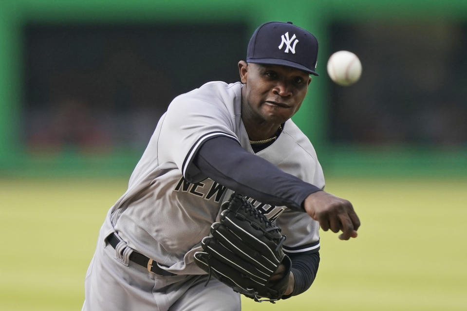 New York Yankees starting pitcher Domingo German delivers in the first inning of a baseball game against the Cleveland Indians, Thursday, April 22, 2021, in Cleveland. (AP Photo/Tony Dejak)