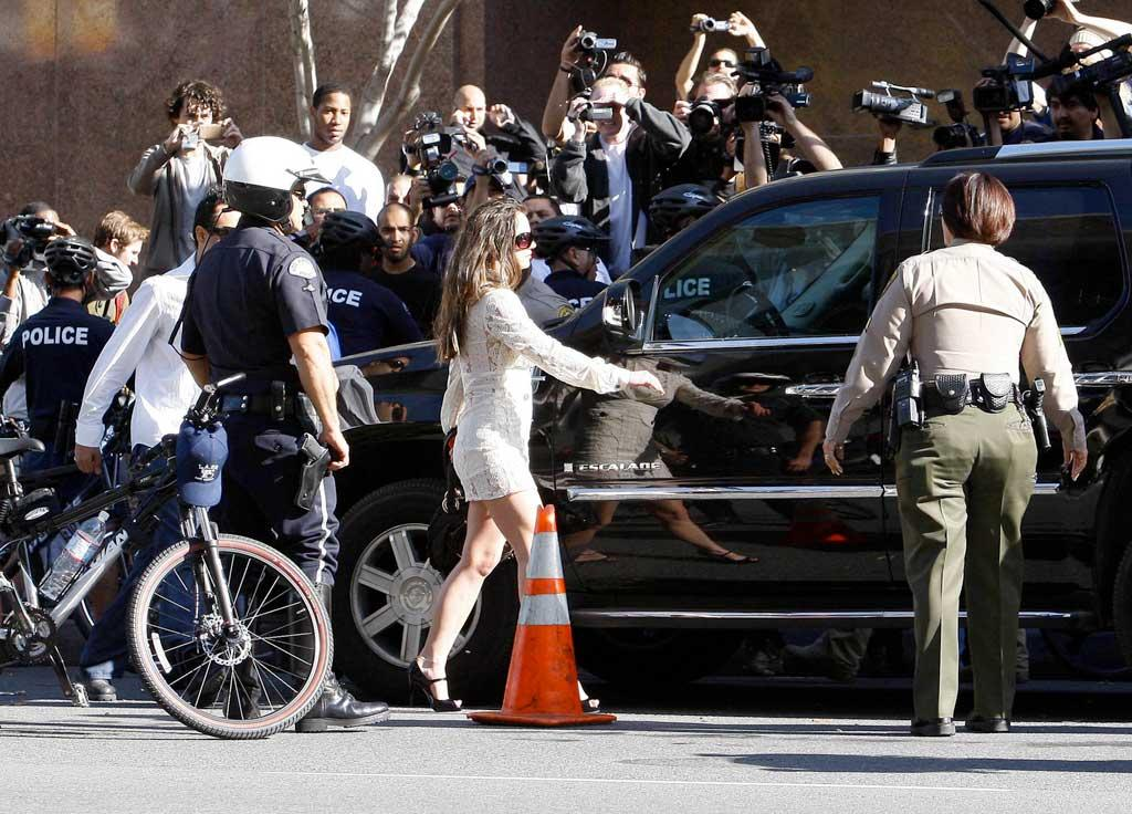 "With dozens of cameras in her face, Britney Spears reportedly yelled ""I'm not doing it, I'm not doing it,"" before getting in her car and abruptly leaving Monday's custody hearing before it even began. Some celeb watchers fear the media frenzy surrounding the pop star may endanger her safety. David Rohmer/<a href=""http://www.x17online.com"" target=""new"">X17 Online</a> - January 14, 2008"