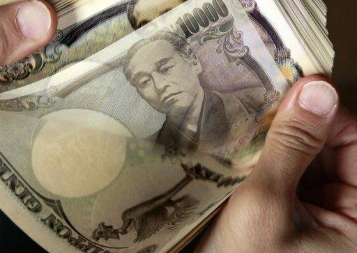 Yen plunges after conservative win in Japan elections