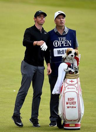 FILE PHOTO - Golf - The 146th Open Championship - Royal Birkdale - Southport, Britain - July 22, 2017 - Northern Ireland's Rory McIlroy stands with his caddie J. P. Fitzgerald during the third round. REUTERS/Hannah McKay/File Photo