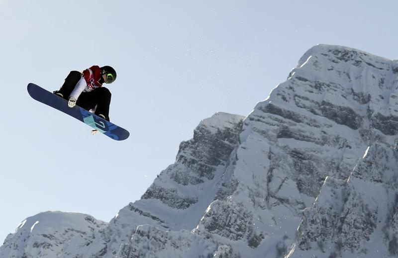 Canada's Maxence Parrot performs a jump during the men's slopestyle snowboarding qualifying session at the 2014 Sochi Olympic Games in Rosa Khutor