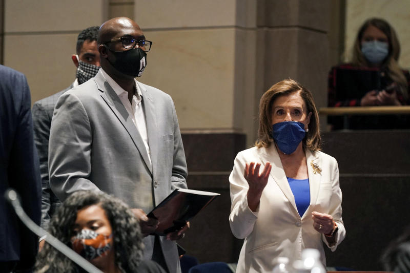 Philonise Floyd, a brother of George Floyd, and House Speaker Nancy Pelosi of Calif., arrive for a House Judiciary Committee hearing on proposed changes to police practices and accountability on Capitol Hill, Wednesday, June 10, 2020, in Washington. (Greg Nash/Pool via AP)