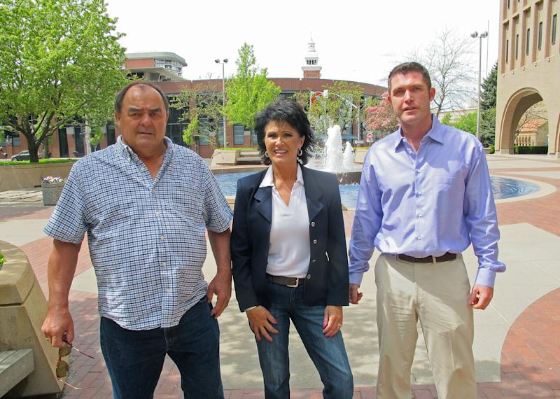 In this Thursday, May 8, 2014 photo, from left, Larry Harvey, Rhonda Firestack-Harvey, and Rolland Gregg stand in the plaza in front of the federal courthouse in Spokane, Wash. The three are charged with growing marijuana at a remote farm near Kettle Falls, Wash. Each face mandatory minimum sentences of at least 10 years in prison after they were caught growing about 70 pot plants on their rural, mountainous property. Medical marijuana advocates have cried foul, arguing the prosecution violates Department of Justice policies announced by Attorney General Eric Holder last year that nonviolent, small-time drug offenders shouldn't face lengthy prison sentences. (AP Photo/Nicholas K. Geranios)