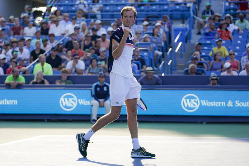 Daniil Medvedev, of Russia, celebrates after defeating David Goffin, of Belgium, in the men's final match during the Western & Southern Open tennis tournament Sunday, Aug. 18, 2019, in Mason, Ohio. (AP Photo/John Minchillo)