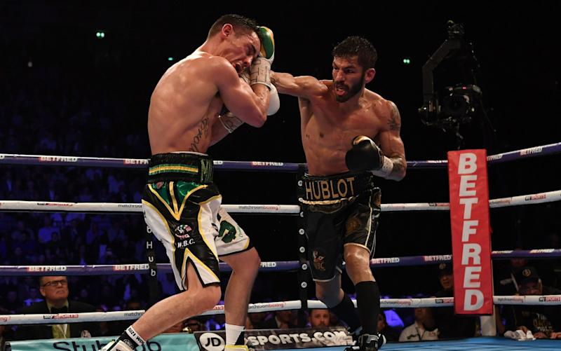 Jorge Linares catches Anthony Crolla - Credit: AFP