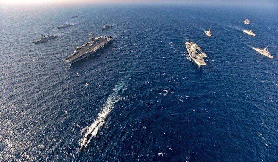 Aircraft carriers and warships participate in a joint exercise of the Quad – India, US, Japan and Australia – in November 2020. Photo: Indian Navy via AP
