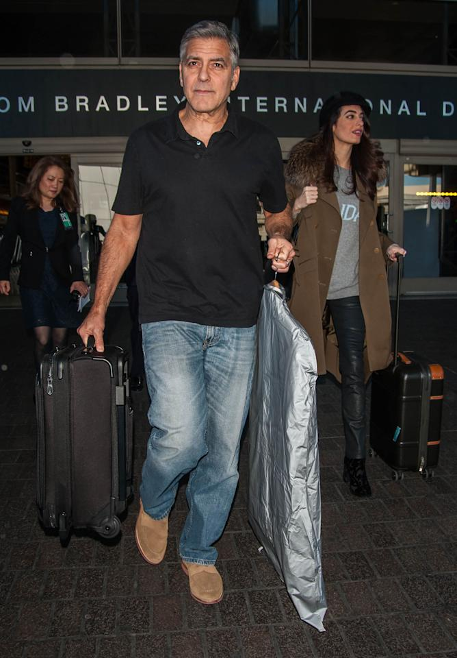 "<p></p><p>Talk about sophisticated yet comfy travel style! While jetting off with husband George Clooney, Amal opted for chic leather pants, a <a rel=""nofollow"" rel=""nofollow"" href=""http://www.popsugar.com/fashion/Amal-Clooney-Alberta-Ferretti-Sunday-Sweater-Jan-2017-43067604#photo-43067604"">fun ""Sunday"" sweater</a> and a neutral coat with fur detailing. Of course, the oversized look kept persistent pregnancy rumours afloat, but whether she's expecting or not (and really, it's not our business!), this travel look is all kinds of #StyleGoals.<i> (Photo via Splash News)</i></p><p></p>"