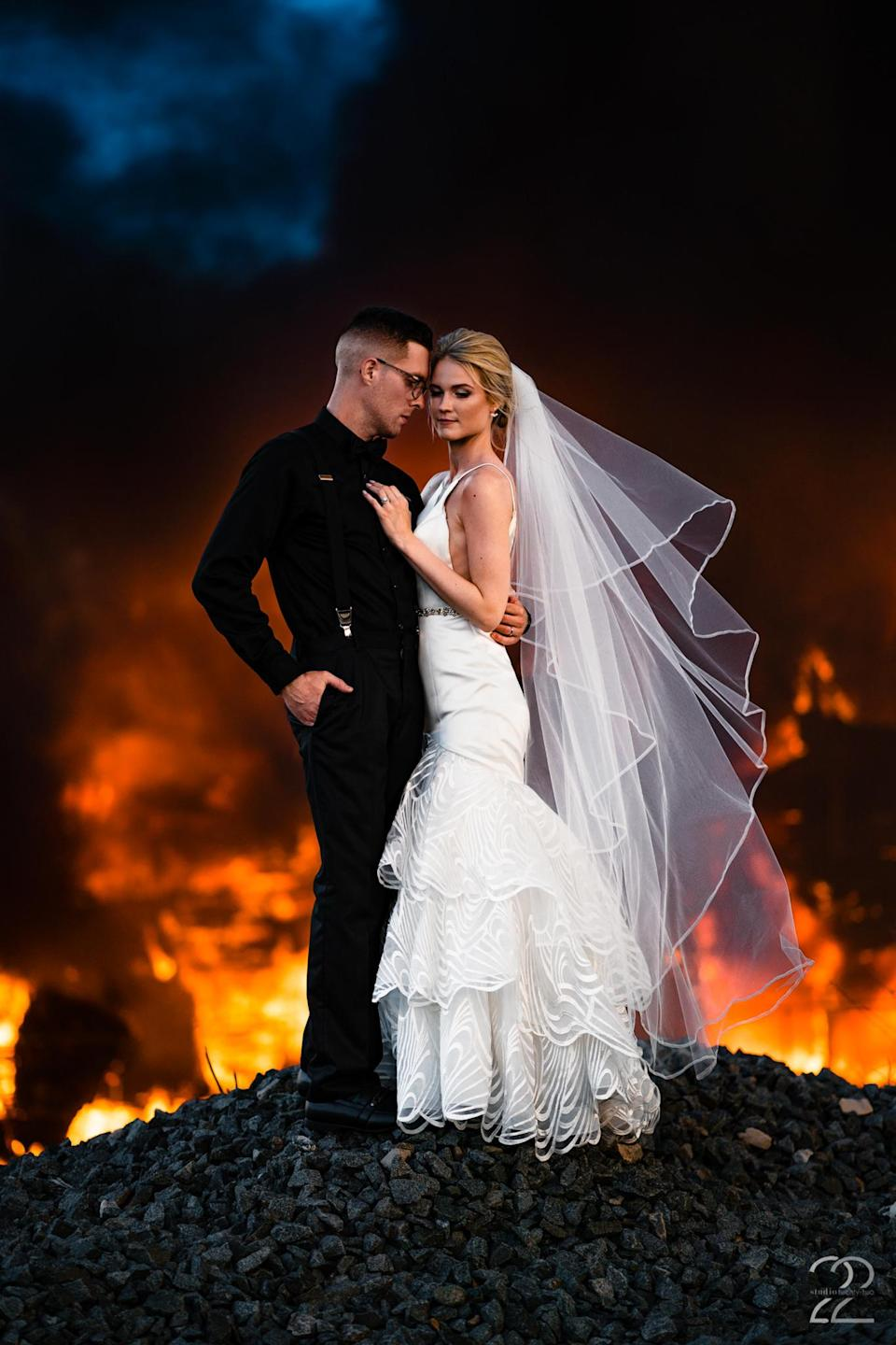 Dillon and Corrie Jameson pose for breathtaking photos with a flaming background. (Photo: Studio 22 Photography, Destination Wedding and Engagement Photographer)