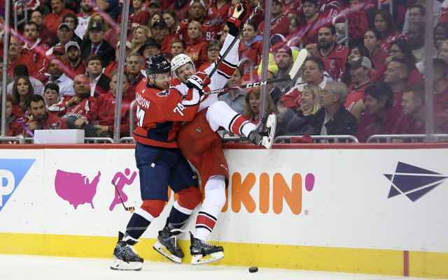 Washington Capitals defenseman John Carlson (74) checks Carolina Hurricanes left wing Warren Foegele, right, into the boards during the first period of Game 7 of an NHL hockey first-round playoff series, Wednesday, April 24, 2019, in Washington. (AP Photo/Nick Wass)