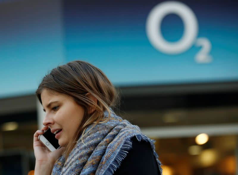 FILE PHOTO: A woman speaks on a mobile telephone outside an O2 store in central London