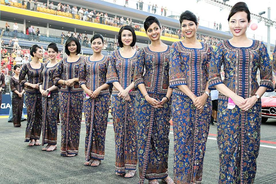 Grid girls before the start of the race of the Formula One Singapore Airlines Singapore Grand Prix on 21 September 2014. (PHOTO: Getty Images)