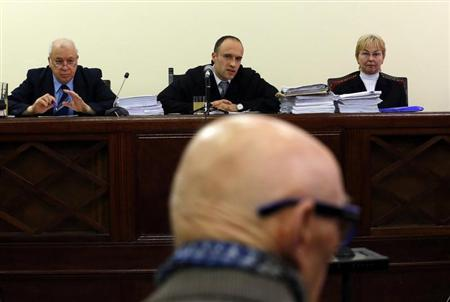 Former Communist Party leader Bela Biszku listens to judge Szabolcs Toth during his trial in Budapest