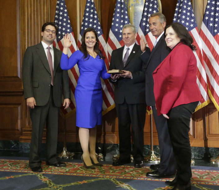 House Speaker John Boehner of Ohio administers the House oath to Rep. Elise Stefanik, R-NY., during a ceremonial re-enactment swearing-in ceremony, Tuesday, Jan. 6, 2015, in the Rayburn Room on Capitol Hill in Washington. From left are, Stefanik's brother Matt, and their parents Ken and Melaine Stefanik. (Photo: Pablo Martinez Monsivais/AP)
