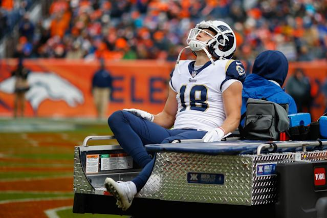 Rams wideout Cooper Kupp was carted off the field after suffering a leg injury against the Broncos. He later returned to the sideline. (Getty Images)