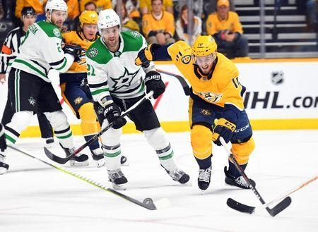 Apr 20, 2019; Nashville, TN, USA; Nashville Predators center Colton Sissons (10) moves for the puck against Dallas Stars defenseman Ben Lovejoy (21) during the first period in game five of the first round of the 2019 Stanley Cup Playoffs at Bridgestone Arena. Mandatory Credit: Christopher Hanewinckel-USA TODAY Sports