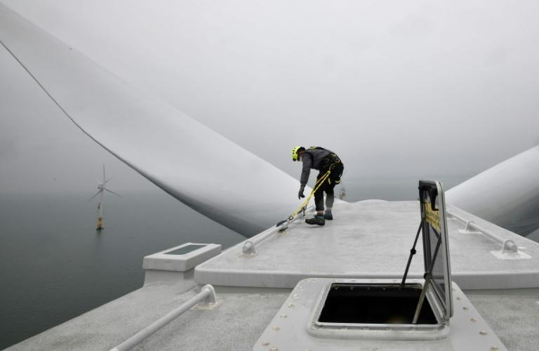 An engineer checks the top of a turbine tower at an offshore wind farm in waters some 10 kilometres (6.2 miles) off Gochang.