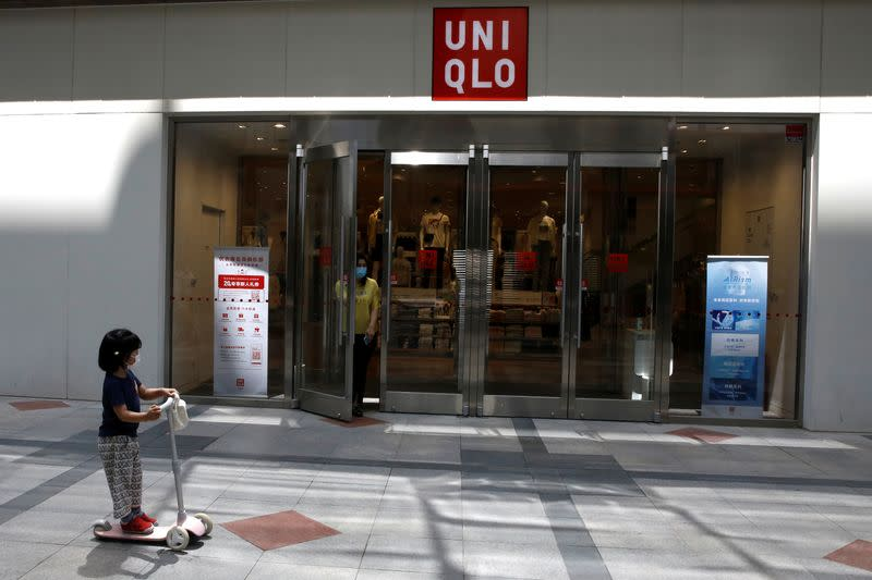 Woman walks out of a Uniqlo store in Beijing