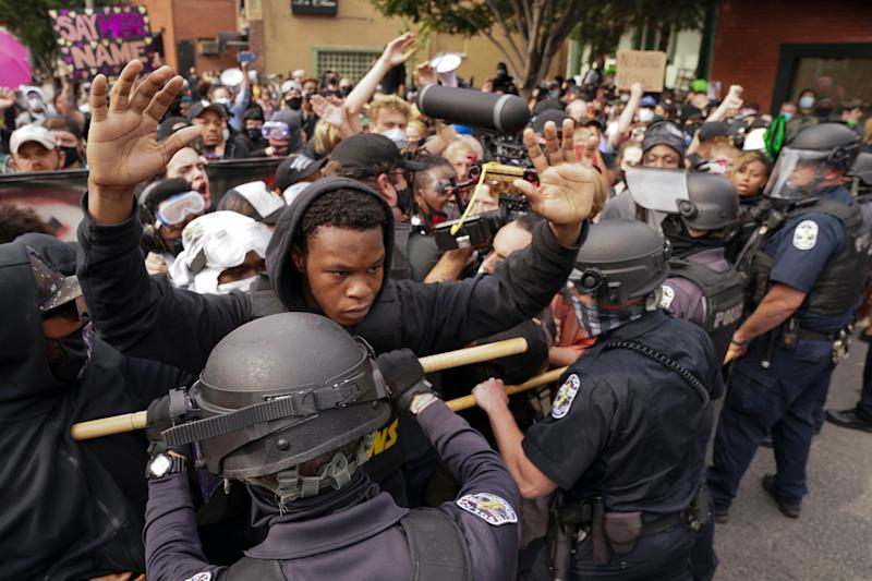 Angry clashes between police and protesters broke out in Louisville on Wednesday night (Copyright 2020 The Associated Press. All rights reserved)
