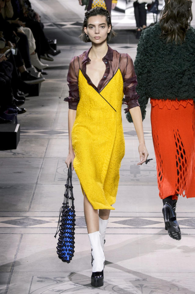 <p>A model at Mulberry wore a sheer plum-colored blouse underneath a bright yellow dress. </p><p><i>(Photo: ImaxTree)</i></p>