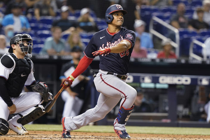 Washington Nationals' Juan Soto (22) hits a two-run home run during the third inning of a baseball game against the Miami Marlins, Wednesday, Sept. 22, 2021, in Miami. (AP Photo/Marta Lavandier)