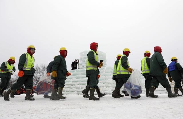 Inmates from the Moriah Shock Incarceration Correctional Facility arrive to help construct the Saranac Lake Winter Carnival ice palace on Monday, Jan. 28, 2013, in Saranac Lake, N.Y. (AP Photo/Mike Groll)